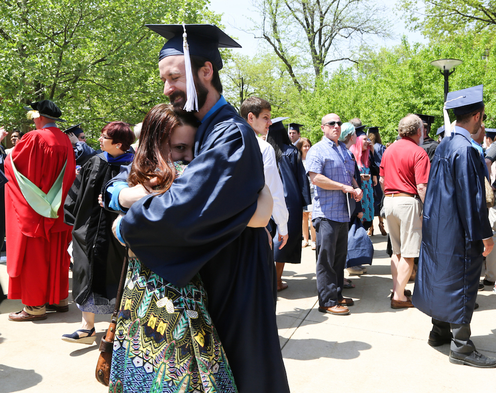 Graduate Hugs Guest After Ceremony