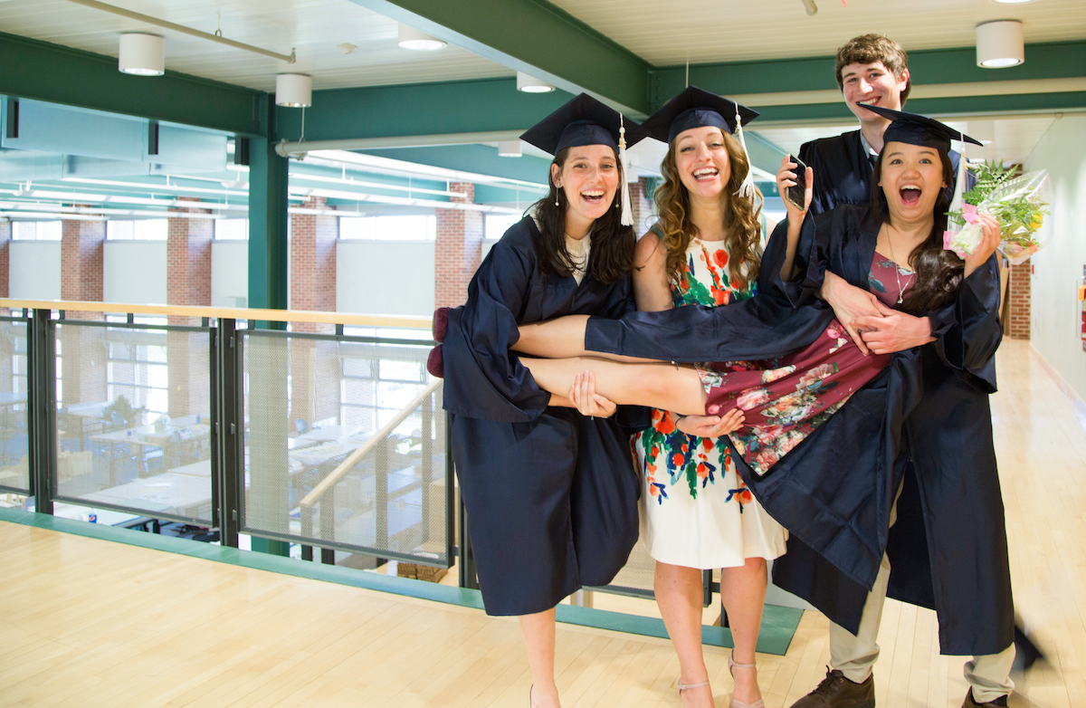 Landscape Architecture graduates pose for a picture in the Stuckeman Family Building, lifting a fellow graduate. Photo Credit: Stephanie Swindle